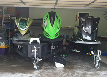head on view of three modified jetskis