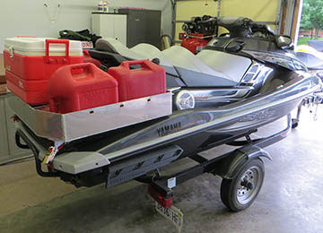rear quarter view of jetski loaded with extra gas cans and coolers