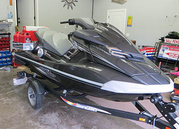 front quarter view of jetski loaded with extra gas cans and coolers