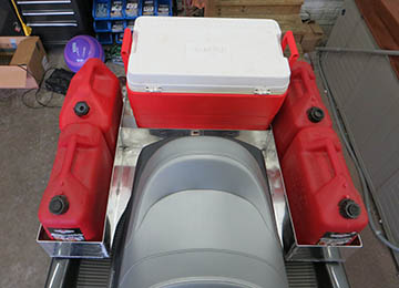 above view of jetski loaded with extra gas cans and coolers